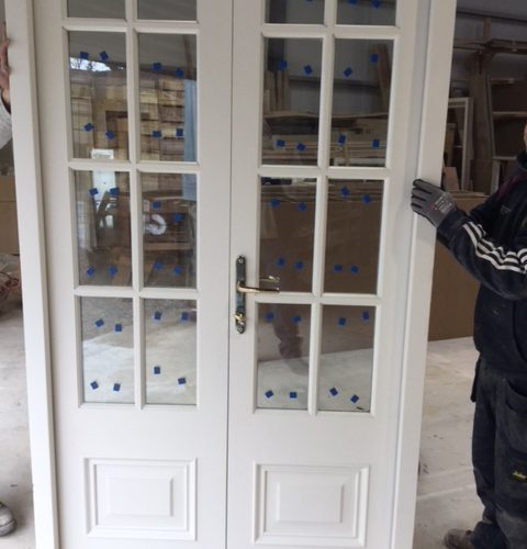 A Joiner Working on a new door