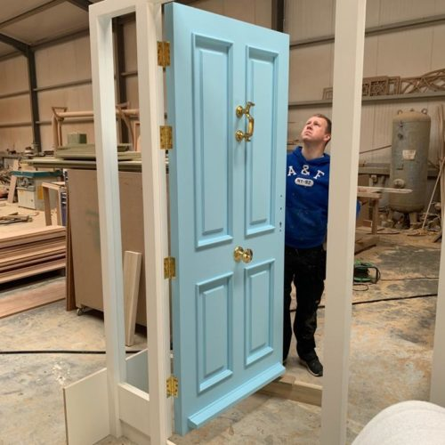 Joiner Inspecting a Door and Frame